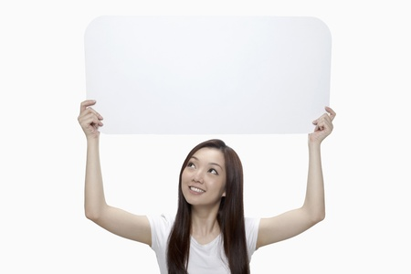 above head: Happy woman holding blank placard above her head