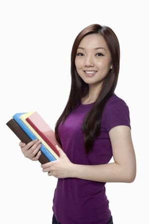 Woman holding books Stock Photo - 17255533