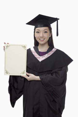 Woman in graduation robe holding blank certificate  Stock Photo - 17255519