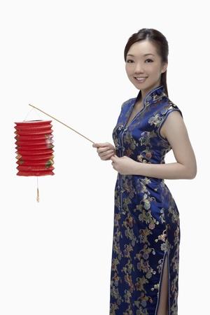 Woman in cheongsam holding paper lantern Stock Photo - 17255559