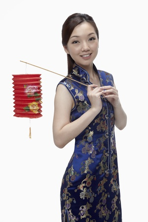 Woman in cheongsam holding paper lantern  Stock Photo - 17255534
