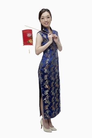 Woman in cheongsam holding paper lantern  photo