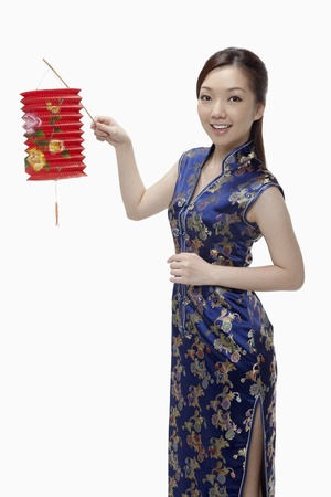 Woman in cheongsam holding paper lantern Stock Photo - 17255518