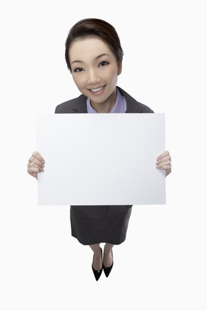 Businesswoman holding blank placard  Stock Photo - 17255589