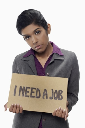 Businesswoman holding  I need a job  sign  Stock Photo - 17320431