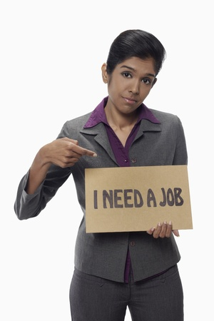 demotivated: Businesswoman holding  I need a job  sign
