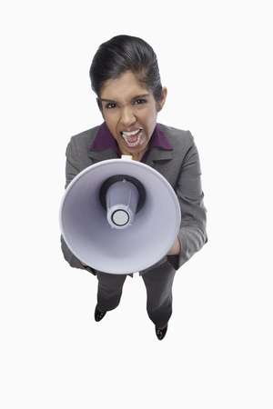 Businesswoman shouting through megaphone  Stock Photo - 17320419