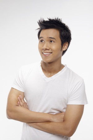 Happy man with arms across his chest, looking away Stock Photo - 17340263