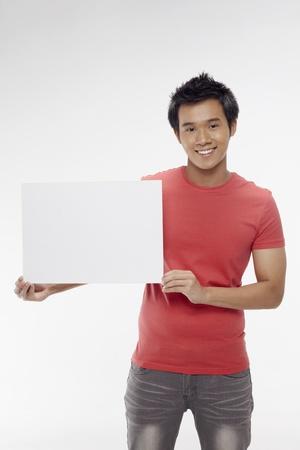 Man holding blank placard Stock Photo - 17340271