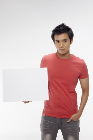 Man holding blank placard Stock Photo - 17340292