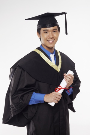 Man in graduation robe holding his diploma scroll photo
