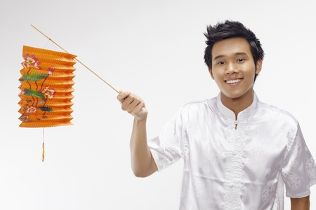 Man in traditional clothing holding paper lantern Stock Photo - 17340264