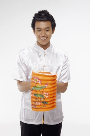 Man in traditional clothing holding paper lantern Stock Photo - 17340125