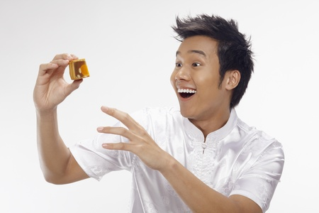 Man holding a piece of sliced mooncake photo