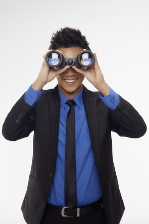 Businessman looking through binoculars Stock Photo - 17340301