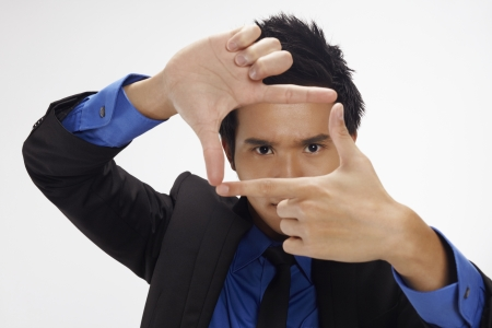 Businessman making a box frame with his fingers Stock Photo - 17340294