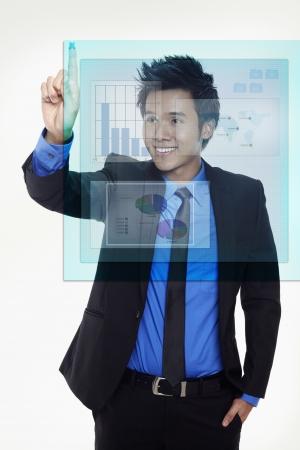 Businessman using digital screen Stock Photo - 17340275