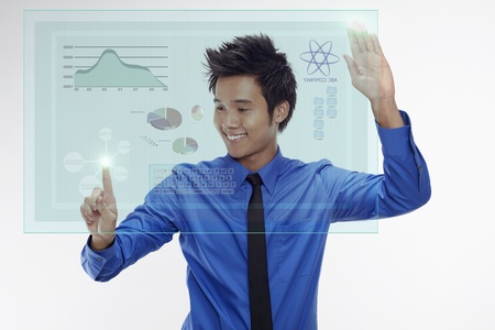 Businessman using digital screen Stock Photo - 17340316