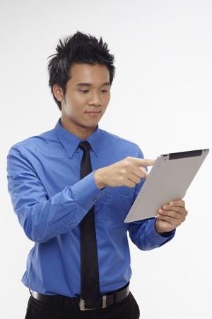 Businessman using digital tablet Stock Photo - 17340289