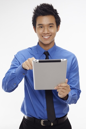 Businessman using digital tablet Stock Photo - 17340278