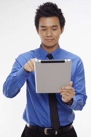 Businessman using digital tablet Stock Photo - 17340299