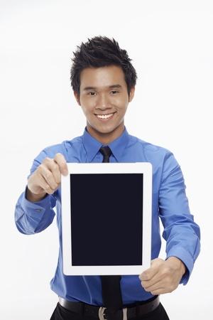 Businessman showing digital tablet Stock Photo - 17339820