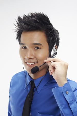 Businessman wearing headset Stock Photo - 17340317
