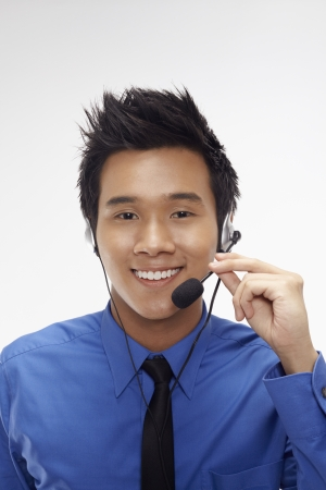 Businessman wearing headset Stock Photo - 17340328