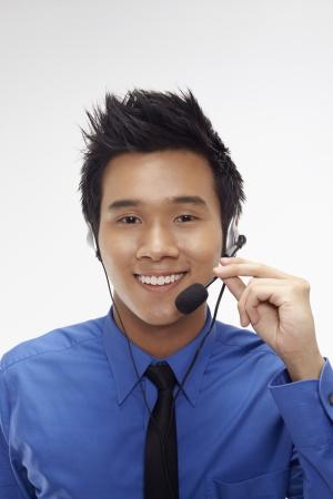 Businessman wearing headset Stock Photo - 17340328