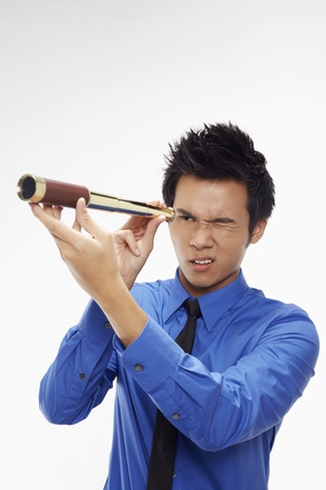 Businessman looking through telescope Stock Photo - 17340296