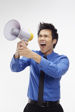 Businessman screaming into megaphone Stock Photo - 17340277