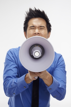 Businessman screaming into megaphone Stock Photo - 17340308