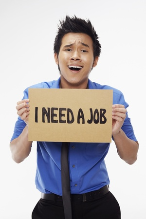 Businessman holding  I need a job  sign Stock Photo - 17340284
