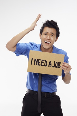 Businessman holding  I need a job  sign Stock Photo - 17340276