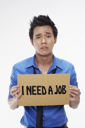 Businessman holding  I need a job  sign Stock Photo - 17340304