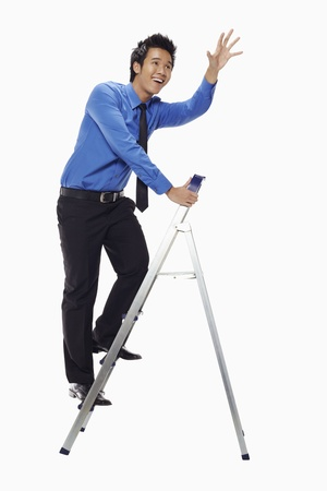 Businessman on ladder with his arms reaching out Stock Photo - 17339809