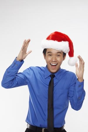 wearing santa hat: Businessman wearing Santa hat