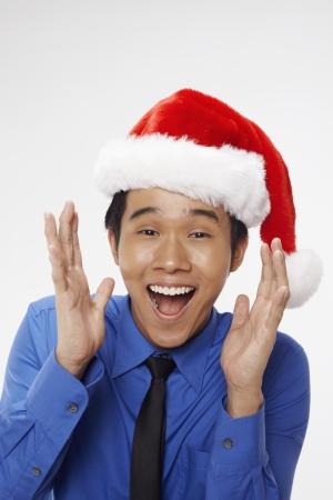 Businessman wearing Santa hat photo