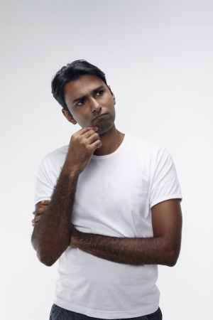 Man contemplating with hand on chin Stock Photo - 17912840