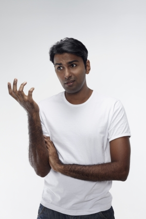 frowning: Confused man with hand gesture Stock Photo