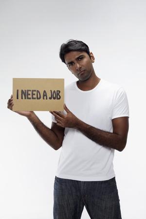 Man holding  I need a job  sign Stock Photo - 17914492