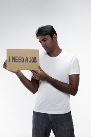 Man holding  I need a job  sign Stock Photo - 17914487