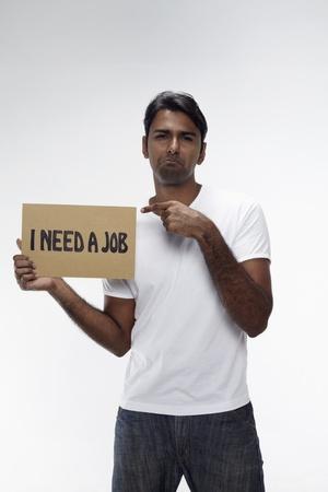 Man holding  I need a job  sign Stock Photo - 17914481