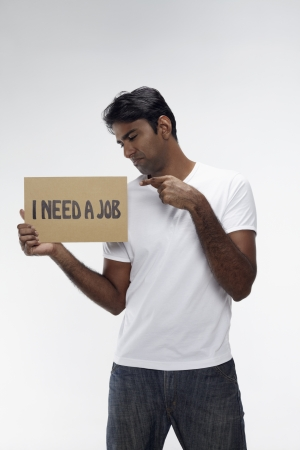 Man holding  I need a job  sign Stock Photo - 17914486