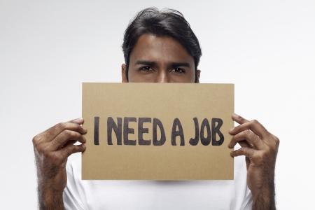 Man holding  I need a job  sign Stock Photo - 17914488