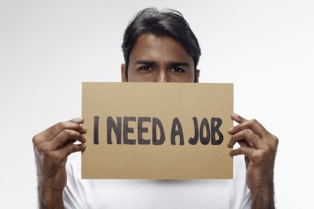 demotivated: Man holding  I need a job  sign
