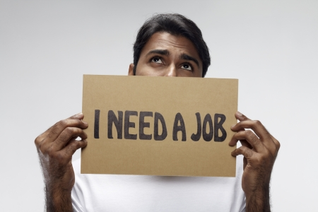 Man holding  I need a job  sign Stock Photo - 17914489