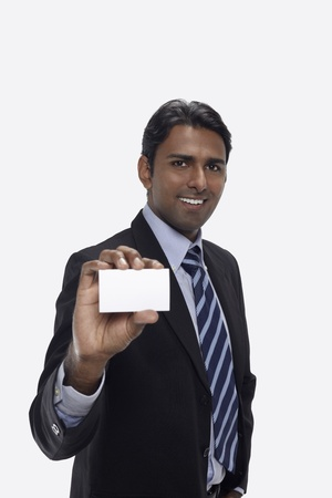 30 34 years: Businessman holding up his business card
