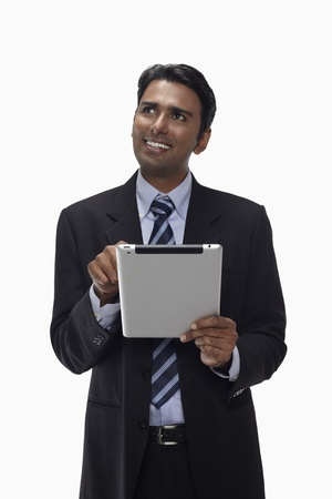 Businessman using digital tablet Stock Photo - 17954565