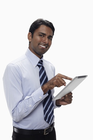Businessman using digital tablet Stock Photo - 17954573